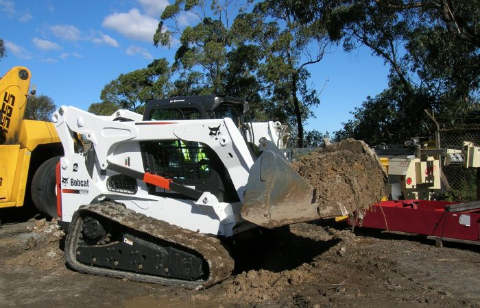 Bobcat Posi-track with multiple forestry attachment hire gold coast t870