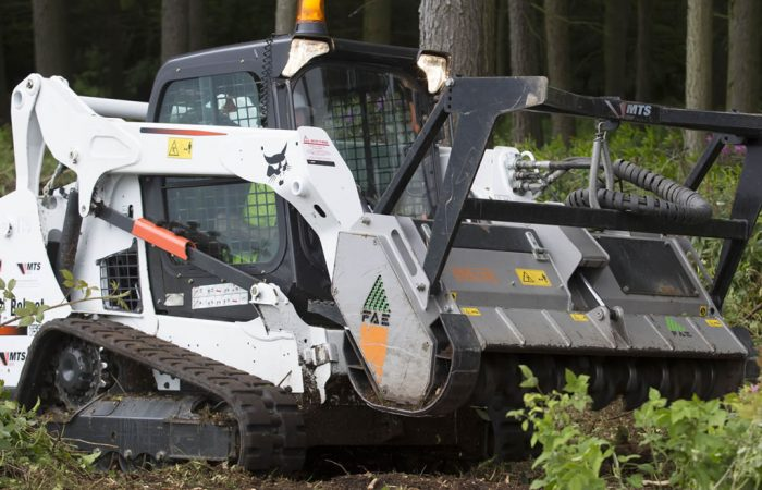 Posi Track Bobcat with mulching attachment for clearing trails Gold Coast Brisbane