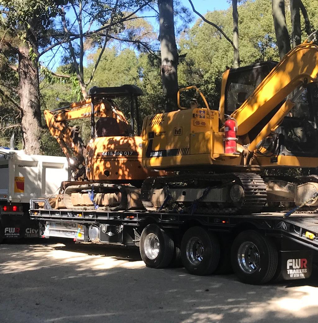 excavator machinery floating float hire gold coast