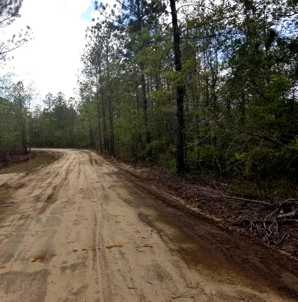 unsealed dirt acreage driveway cutting gold coast brisbane
